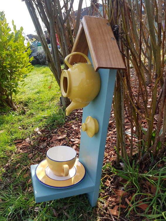 Yellow teapot bird feeder