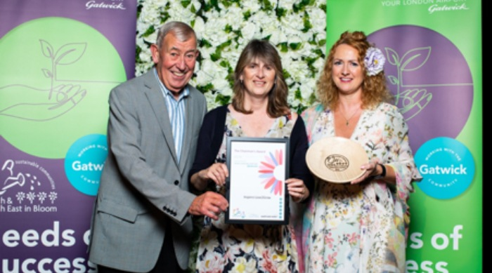 Catherine Waters-Clark and Yvonne Mendelsohn receiving the Chairman's award from Horticulturalist & Writer Jim Buttress