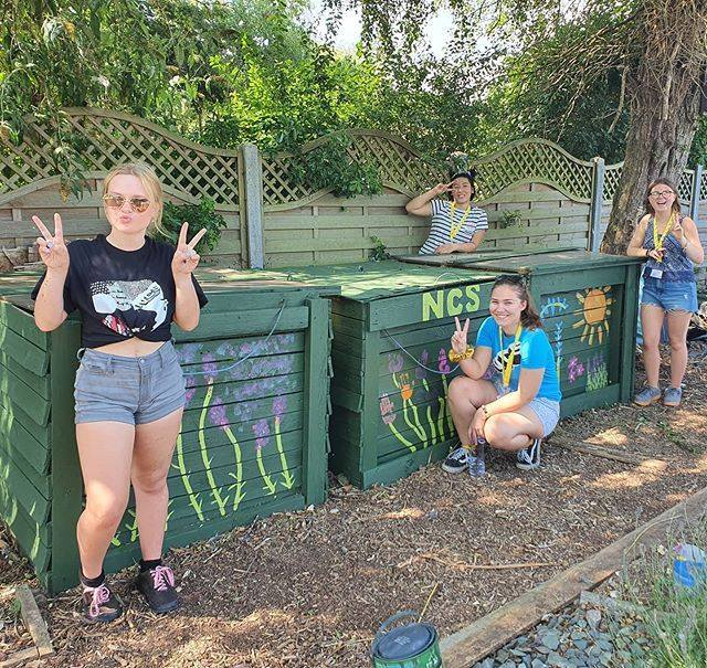 NCS Volunteers Painting Compost Bins